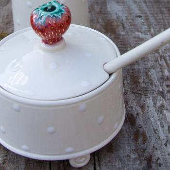 Strawberry jam pot with scroll feet and spoon